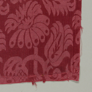 Fairly small scale allover repeat of two stylized floral motifs in staggered horizontal rows.