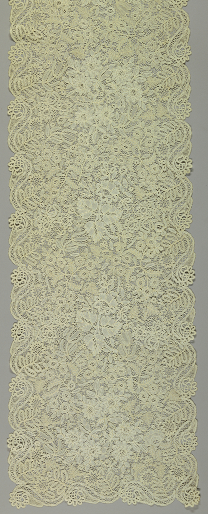 Shawl or stole of Honiton bobbin lace in a dense floral pattern.