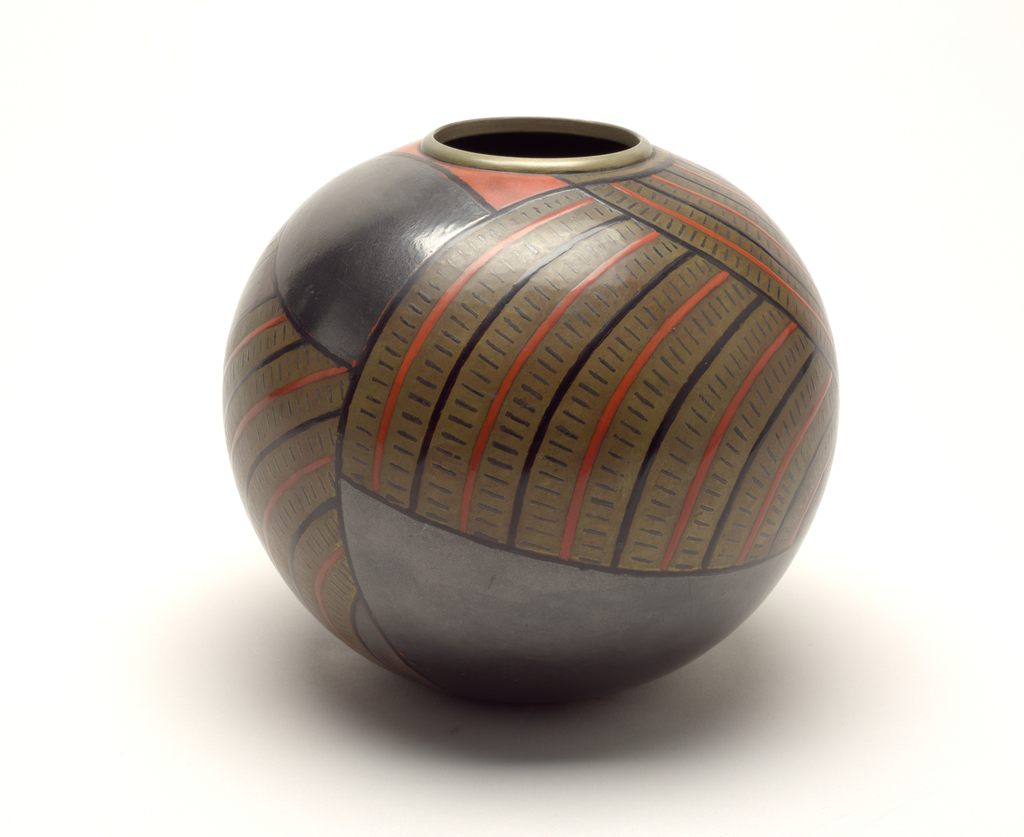 Globular form, the brass surface with caramel-colored patination and black and cinnabar-colored lacquer geometric decoration of curving lines and dashes, and cinnabar and gun-metal gray colored fields; circular mouth with nickled collar.