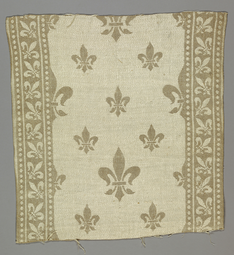 Fleur-de-lys motifs in diagonal repeat in central field with side borders of fleur-de-lys within pearled bands.