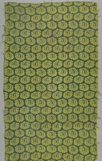 Yellow-green damask with an allover pattern of asymmetrical leaf or floral form in rows repeated in offset rows with direction reversed.