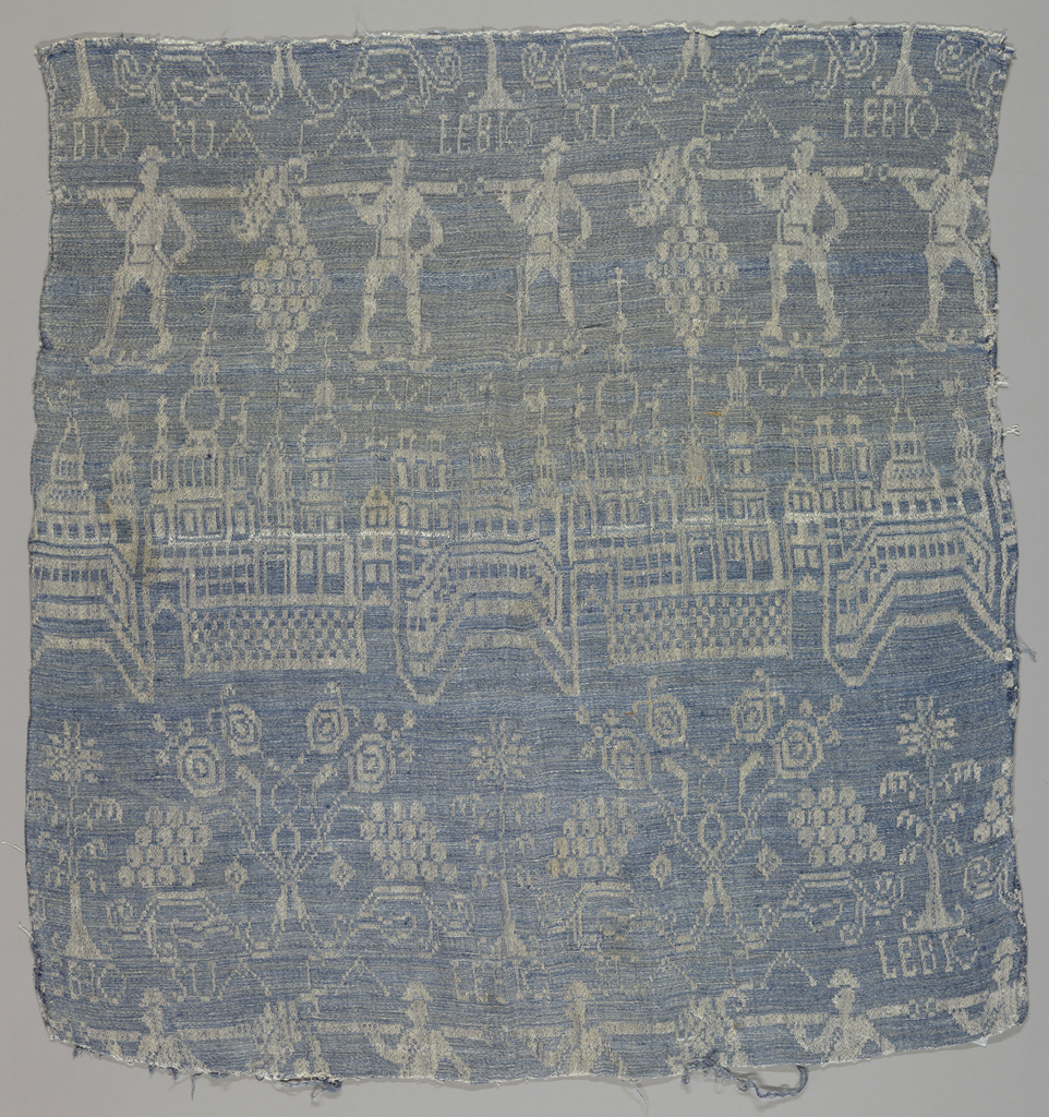 Blue and white damask with depictions of Jerusalem and the Spies of Eschol.