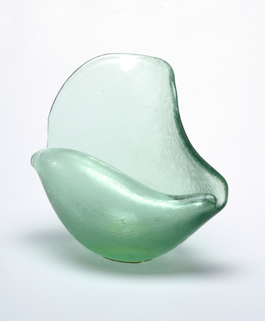 Green textured glass in the form of a conch shell.