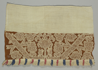 Fragment of a fringed border with white embroidery on reddish-brown gauze.