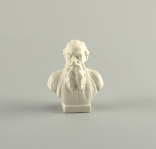 Bust of man, slightly balding, with long beard, on small square base