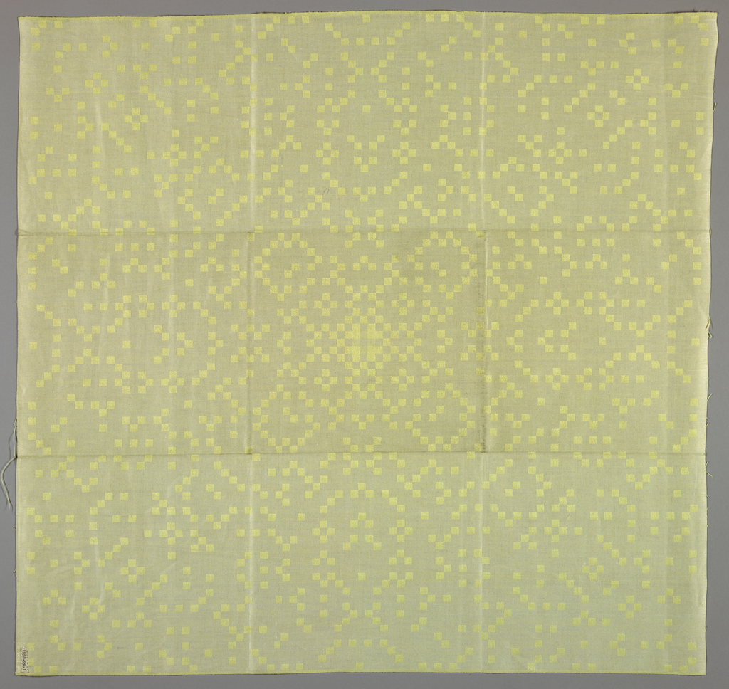 Heavy satin damask in yellow and white with pattern of small squares arranged to show the Gaussian primes, a musical term.