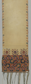 Long linen scarf with ends embroidered in colored silks of orange, pink, gold and blue, in a stylized floral design. Borders on long edges, fringe on ends.