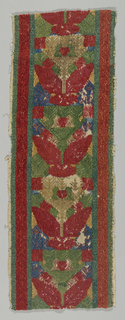 Vertical design of leaves and abstract in red, green, blue and beige. Piece probably salvaged from a bed curtain.