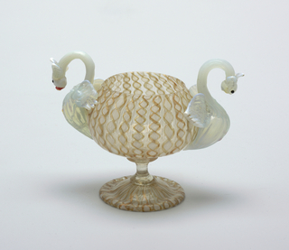 Copper & white bowl flanked by dragon-like figures as handles