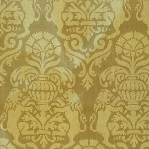 Yellow damask with an allover design of a carnation in a vase above two confronted, rampant lions forming an ogival shape.