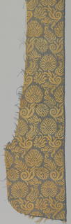 Chasuble piece with medium-scale, close set diagonal repeat of stylized floral sprays. Alternate rows have small birds perched on flowers. One selvage continuous with field and ends in a bunch of warps.