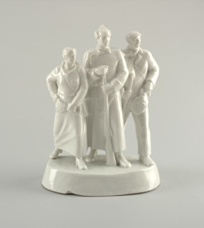 Three standing figures on oval base: in the center a Red Army soldier with rifle, to the right of him a man with gas mask and rifle, to the left soldier a woman with gas mask; unpainted.