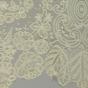 Stole of machine net appliqued using bobbin lace in an allover floral design.