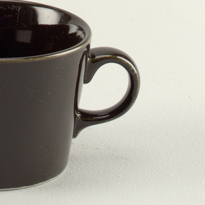 """Cup with straight sides flared to plain lip.  Applied """"C"""" shaped handle."""