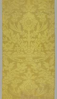 Yellow damask with a large scale symmetrical design showing crown and foliage.