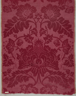 Short length of red damask in a symmetrical arrangement of oversized flowers and leaves.
