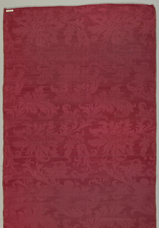 Length of red satin damask in an allover floral pattern in an 18th century style.