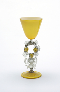 Yellow goblet, clear glass stem