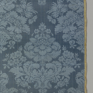 Medium-scale design of delicate symmetrical bouquets, each diamond shaped and closely placed so that a trellis shape is created by the negative space of the pattern. Two salmon and yellow striped selvages in warp twill.