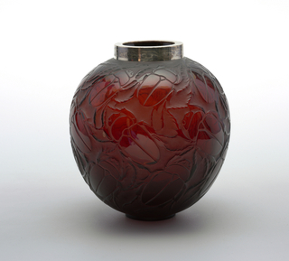 Clear brown glass, globular body terminating in small shallow base, surface patterned with large beetles.  Top rim fitted with silver collar with incised abstract decoration.