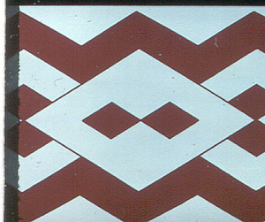Repeating motif of diamond shapes linked together. Printed in red on white.