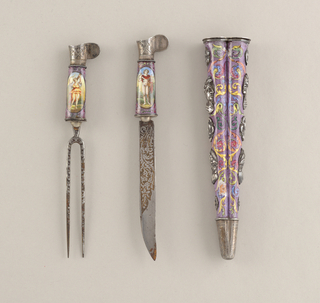 Blade straight-sided, the upper edge tapering towards the point. The blade engraved with acanthus foliage and flowers. Handle enameled, a medallion on each side of the handle: one showing Apollo, the other one of the Virtues, (Constancy?). Handle has flaring shape with a projecting ear on one side, silver engraved with two crossed swords.