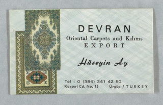 Card has woven background in light gray and white; two textiles overlapping on left and text on right in black: DEVRAN / Oriental Carpets and Kilims / EXPORT / Hüseyin Ay / Tel: 0 (384) 341 42 50 / Kayseri Cd. No. 15  Ürgüp/TURKEY.