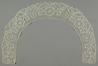 "Deep collar or ""Bertha"" ornamented with flowers and compartments enclosing various stitches."