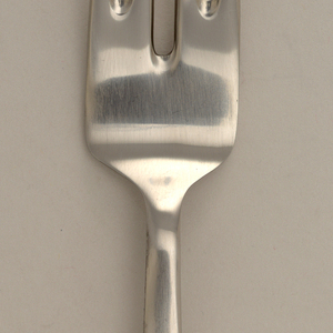 Four-tined fork with two center tines continuing deeper into square bowl than other tines. Straight shaft expanding to handle.