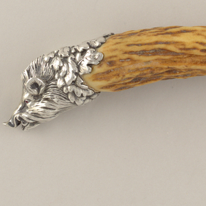 Large, small carving fork (c,d): bone handles with silver boar's head terminals and hinged metal rest on shaft; sharpener.