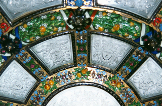Large circular dish in the Renaissance style, constructed of 31 engraved glass panels set in framework of enameled and gilded silver with semi-precious stones.