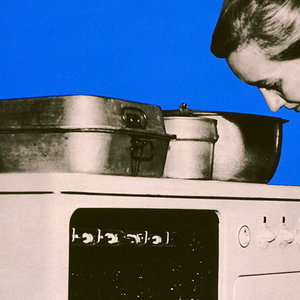 """Poster with a black and white photographic image of a woman removing freshly-baked biscuits from oven, set against a blue printed background, on the bottom half. On the top half of the design, the background is composed of red polka dots on a white background, and the title """"A Better Home"""" appears within a central band of blue in an ovoid shape positioned diagonally."""