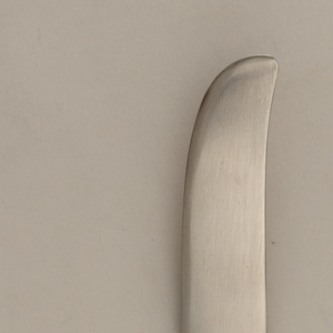 Blade joining raised handle widening towards end.