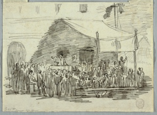 A man stands at a pulpit in a town square addressing a group of listeners.