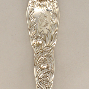 """Four-tined fork with relief-decorated handle in """"Chrysanthemum"""" pattern; engraved """"B"""" in reserve."""