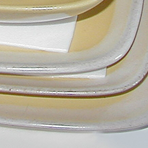 Yellow glaze outside, with stylized flower/foliage motif in lighter color; interior lighter color glaze.