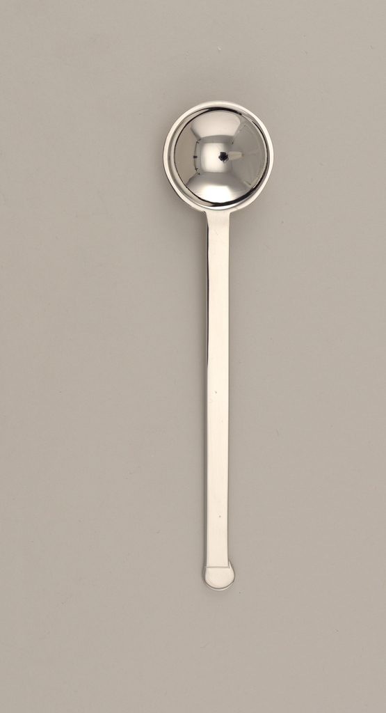 Elongated, flat handles with flat circular terminal. Small, round bowl.