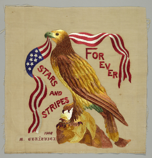 Picture in bright colors of an eagle on a rock with a flag and pennants coming from its beak. Embroidery done over a painted outline.