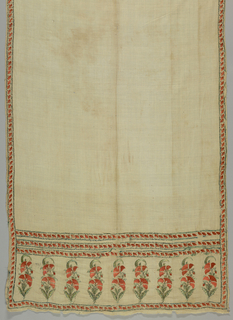 Long narrow sash of white cotton with an embroidered band at both ends, and three narrow guard stripes above and a narrow border on all sides. Bands contain flowering poppy-like plants.