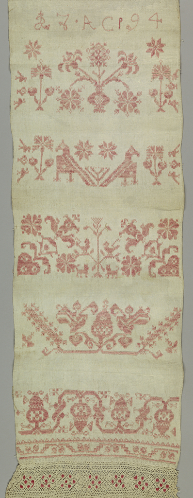Designs in style of Italian Renaissance, showing confronted lions, vases of flowers, addorsed birds, and conventionalized floral patterns arranged as cross borders. Edged, top and bottom with bobbin lace ornamented with red cotton dot.