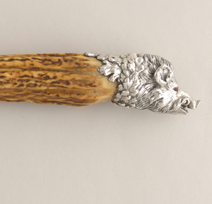 Large carving knife: bone handles with silver boar's head terminals.