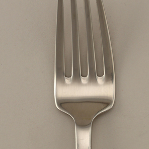 Four-tined fork with square bowl adjoining shaft, widening slightly towards end of square handle.
