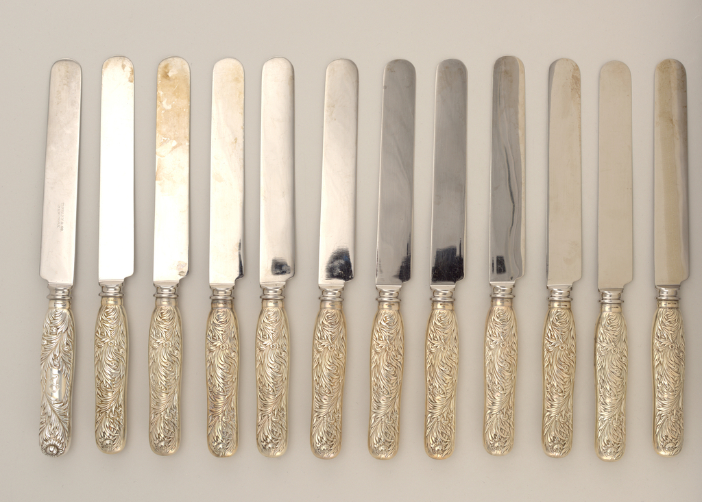 """Rounded steel blade; shaped handle with design in chrysanthemum pattern, with engraved """"B"""" in reserve."""