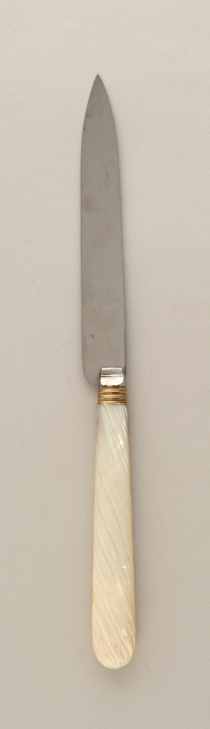 One of twelve steel-bladed dessert knives with mother-of-pearl handles and gilt bolsters.