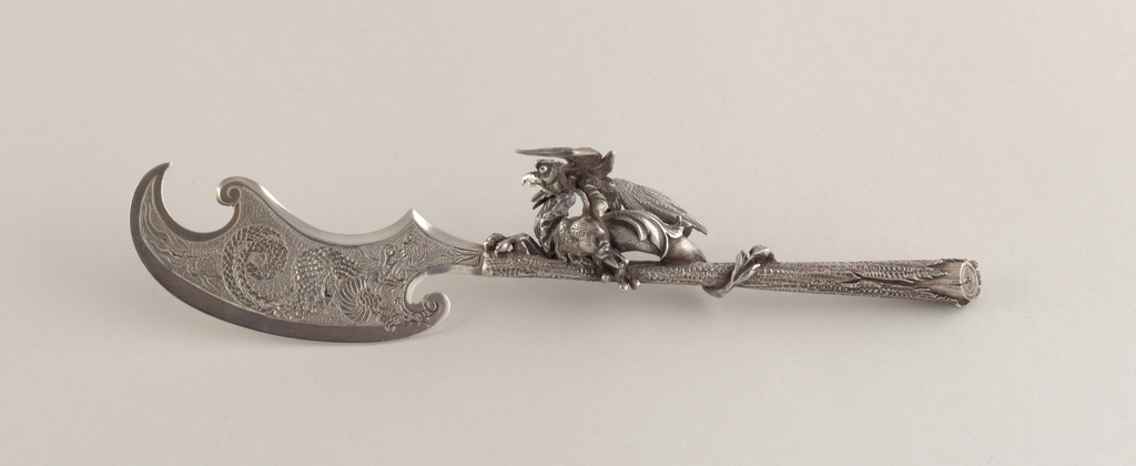 Modeled dragon figure on handle and engraved dragon on blade.