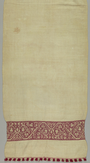 Long narrow cover with a floral vine panel at each end; with fringe. Red silk on white linen.