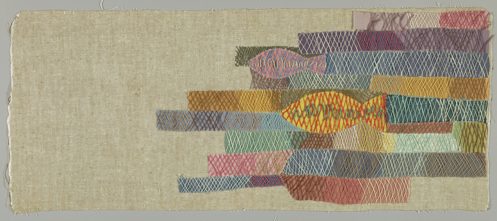 Natural unbleached linen with appliqué of fish and oblong rectangular patches in various materials and colors. Embroidered loosely over this design with colored yarns and string to simulate a net.