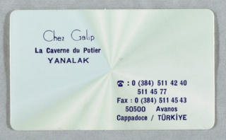 Card with rounded corners; background with radiating light from center; in blue ink, upper left: Chez Galip / La Caverne du Potier / YANALAK; lower right: [telephone image] 0 (384) 511 42 40 / 511 45 77 / Fax : 0 (384) 511 45 43 / 50500 Avanos / Cappadoce/TÜRKIYE.