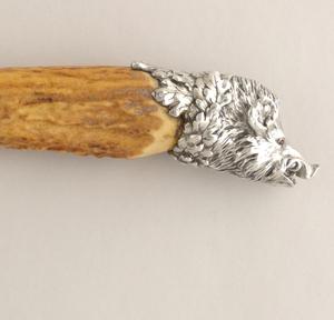 sharpener (e): bone handles with silver boar's head terminals.