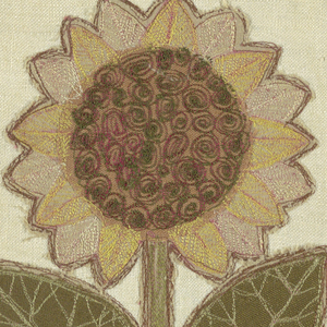 Place mat of white linen hemstitched with applied design of a flower. Machine embroidered in multicolor.